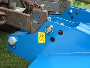 Unique three point linkage hitch system allows the Topper to slide easily over the field surface.
