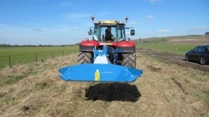 The 240S will break back if an obstacle is encountered and travels within the width of the tractor for transport